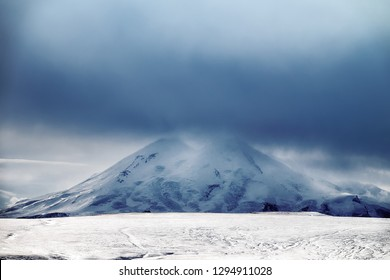 Mount Elbrus (Elborus) the highest mountain peak in Europe in the Great Caucasus range (adolescent mountains) - geographical border of Asia and Europe, part of world, continents dividing