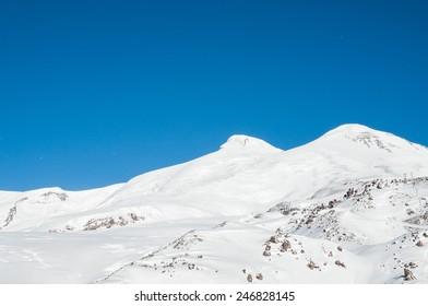 Mount Elbrus, the highest peak of Europe. Ski resort. Caucasus, Russian Federation. Winter mountains. Beautiful winter landscape