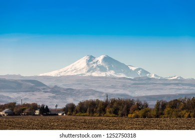 Mount Elbrus is the highest peak of Russia and Europe. Snapshot from a distance of 90 kilometers. HDR image. Caucasus, Russia.