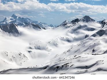 Mount Elbrus, view from the ski station of Gara-Bashi (3.840 m) to the Caucasus mountain range and ski slopes.