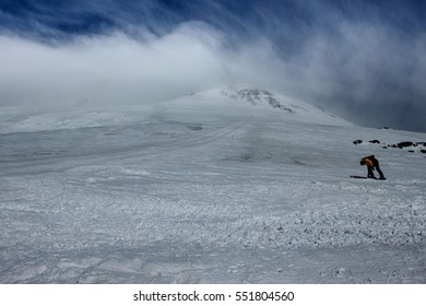 Mount Elbrus. A wide ski slope with views of the peak of mount Elbrus. The altitude of 4600 meters. Clear Sunny day, blue sky and white clouds. Russia. The Caucasus