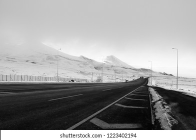 Mount Erciyes volcano covered with snow -paved road in snow landscape of Kayseri, Turkey