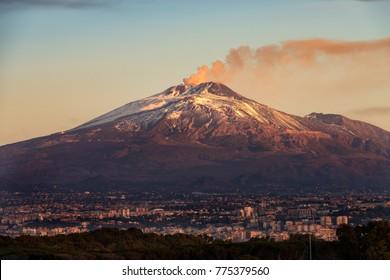 The mount Etna Volcano with smoke and the Catania city, Sicily island, Italy (Sicilia, Italia)