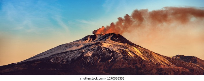 The mount Etna Volcano with smoke at dawn in winter. Catania, Sicily island, Italy, Europe