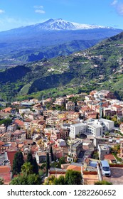 Mount Etna volcano viewed from the town and countryside of Taormina in Sicily, Italy