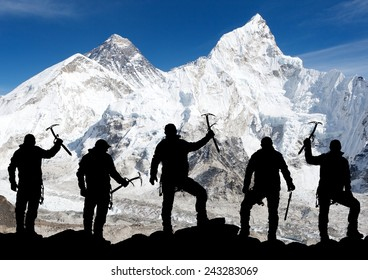 Mount Everest from Kala Patthar and silhouette of men - trek to everest base camp - Nepal