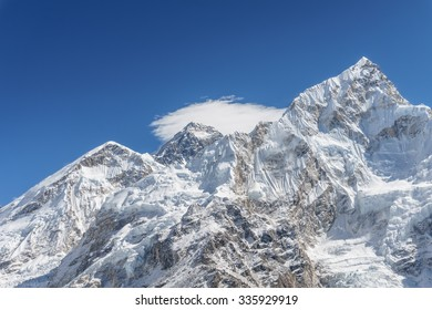 Mount Everest and Nuptse with its slope covered with glaciers and ice-falls. The photo was taken from the summit of Kala Patthar, Nepal