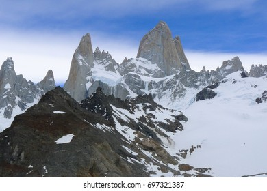 Mount Fitz Roy is a mountain in Patagonia on the border between Chile and Argentina.  Located near El Chalten, Argentina, the peak is 11,020 feet.  This photo is taken from the Argentina side.