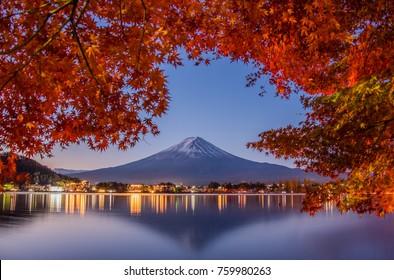 Mount Fuji, Autumn in Mount Fuji, Japan - Lake Kawaguchiko , Colorful Autumn Season and Mountain Fuji with morning fog and red leaves at lake Kawaguchiko, Japan.