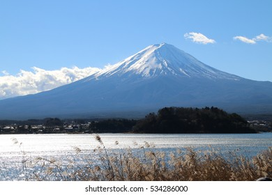 Mount Fuji is the highest mountain in Japan at 3,776.24 m . Mount Fuji's exceptionally symmetrical cone, which is snow-capped several months a year, is a well-known symbol of Japan ?