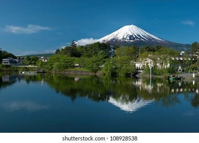 Mount Fuji from Kawaguchiko lake in Japan during the sunrise with beautiful blue sky