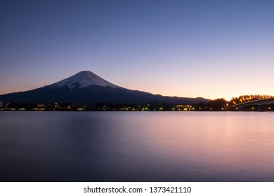 Mount Fuji and the lake in front and the light in the evening