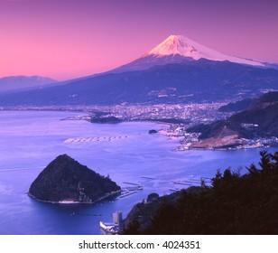 Mount Fuji at night with Suruga Bay in foreground