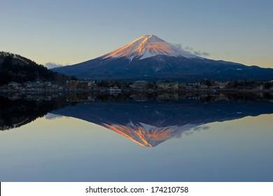 Mount Fuji reflected in Lake Kawaguchi at dawn