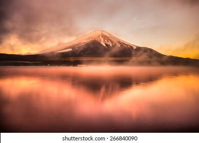 Mount Fuji reflected in Lake Yamanaka at dawn, Japan.