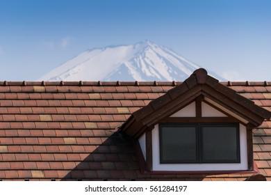 Mount Fuji and a roof of Kawaguchigo Train Station in summer, Yamanashi, Japan