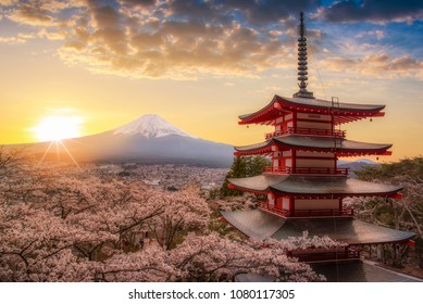 Mount Fuji san beautiful landscapes on sunrise. Fujiyoshida, Japan at Chureito Pagoda and Mt. Fuji in the spring with cherry blossoms.