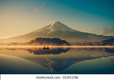 Mount fuji san at Lake kawaguchiko in japan on sunrise.  vintage tone
