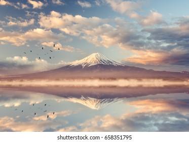 Mount fuji san at Lake kawaguchiko in japan. mt.fuji reflection on sunrise. vintage tone