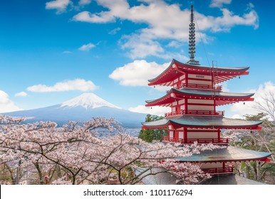 Mount Fujisan beautiful landscapes on blue sky. Fujiyoshida, Japan at Chureito Pagoda and Mt. Fuji in the spring with cherry blossoms.