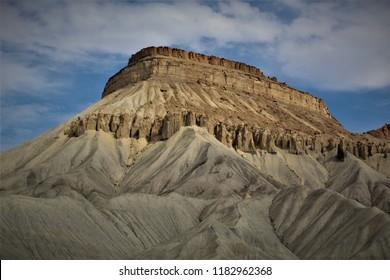 Mount Garfield in Grand Junction, Colorado, looms beneath a blue sky.