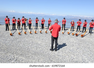 Mount Generoso, Switzerland - 8 April 2017: People playing the alphorn at Mount Generoso on the Swiss alps