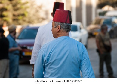 MOUNT GERIZIM DISTRICT, ISRAEL - OCTOBER 14, 2011: Traditional dressed middle aged Samaritan coming to evening prayer at sunset time