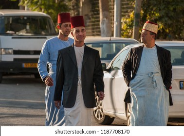 MOUNT GERIZIM DISTRICT, ISRAEL - OCTOBER 14, 2011: Traditional dressed young Samaritans coming to evening prayer at sunset time