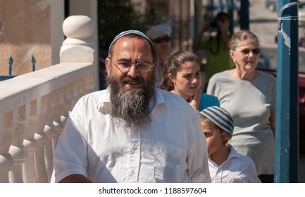 MOUNT GERIZIM DISTRICT, ISRAEL - OCTOBER 14, 2011: Undefined middle aged jewish ultraorthodoxe man with his family walk at samaritans town