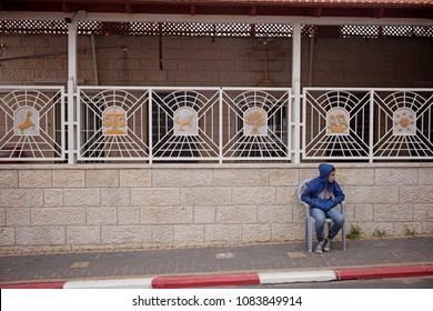 Mount Gerizim, Israel - December 20 2017: A kid sitting outside of the temple of Samaritan in the local Samaritan community on the sacred mountain.