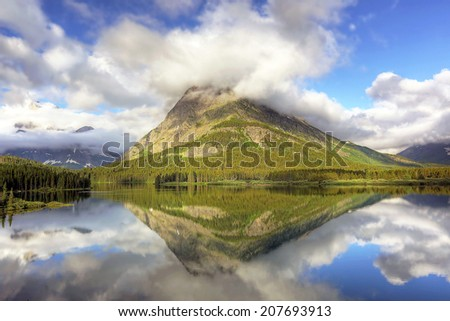 mount grinnell reflecting swiftcurrent lake glacier stock photo