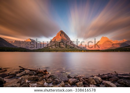 mount grinnell sunrise shores swiftcurrent lake stock photo edit