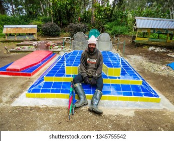 Mount Hagen / Papua New Guinea - Nov 2013: Papuas man on the grave yard in the village near Mt. Giluwe.