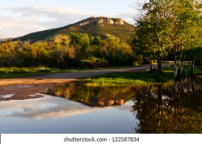 Mount Helena can be seen from many parts of Helena, Montana.  This reflection is not a normal one as it occurred because of a bit of spring flooding.