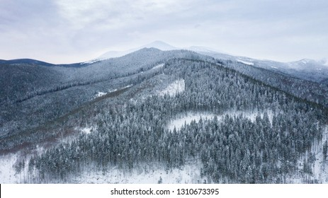 Mount Hood covered in winter snow, Shooting from the air