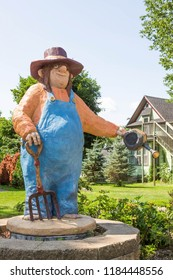MOUNT HOREB, WISCONSIN USA. JULY 28 2018.  A gardner troll stands alongside the Main Street at Mount Horeb, Wisoconsin