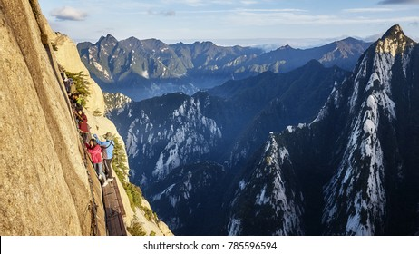 Mount Hua, Shaanxi Province, China - October 6, 2017: Tourists on the Plank Walk in the Sky, worlds most dangerous trail.
