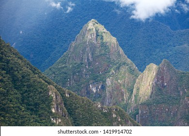 Mount Huayna Picchu and temple, Machu Picchu inca town seen from start of Salkantay trek near Cusco in Peru