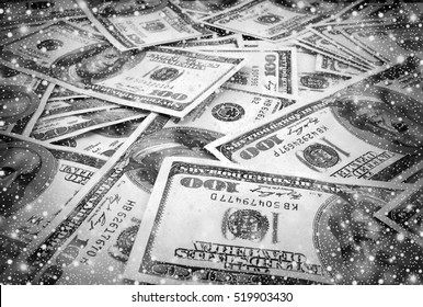 Mount of hundred dollar banknotes with shiny snowfall black and white