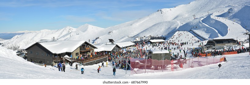Mount Hutt, New Zealand - July 30, 2017: Panoramic view of the Mount Hutt Ski Field at Lunch Time. Skiers prepare to ride on the Chairlift  outside the restaurant, Canterbury New Zealand.