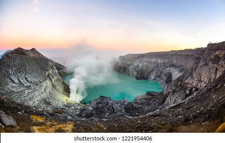 mount ijen volcanic crater at sunrise with sulfur fog
