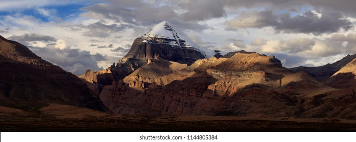 Mount Kailash, Kangrinboqe peak. Ngari, Tibet Autonomous Region of China. Panoramic view with Sunset, dramatic lighting, snow mountain peaks illuminated. Tibetan pilgrimage site, Sacred Mountain