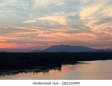 Mount Katahdin in Maine at sunset with a reflecting lake in the foreground