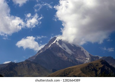 Mount Kazbek in Georgia against the sky and clouds