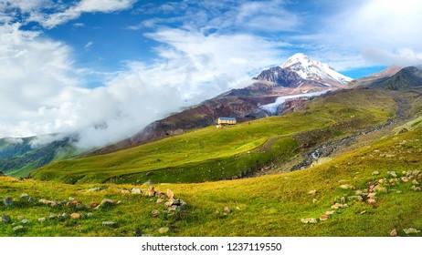 Mount Kazbek. Mountains landscape. Georgian valley. Beautiful highlands in Caucasus