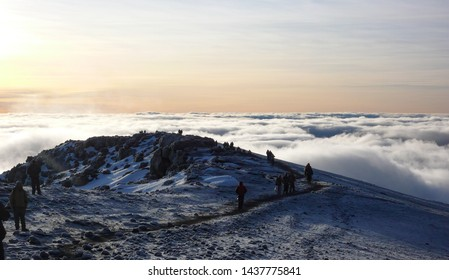Mount Kilimanjaro, Mount Kilimanjaro Province / Tanzania: 7. January 2016: many climbers and mountain guides arrive on the summit of Mount Kilimanjaro just after sunrise