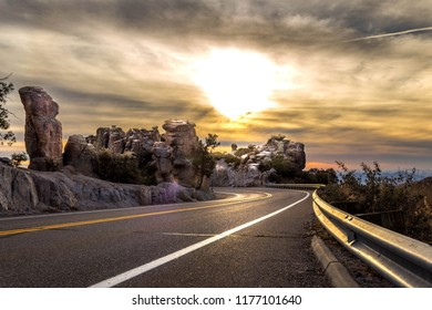 Mount Lemmon Hwy in the Catalina mountains north of Tucson, Arizona. The sunset is reflected in this scenic mountain roadway in Pima county. Hoodoos, rare rock formations dot the landscape. 2018.