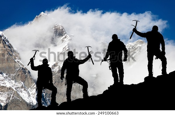 Mount Lhotse and silhouette of men with ice axe - way to everest base camp - Nepal