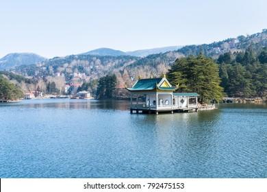 mount lushan landscape of traditional pavilion on lake, China