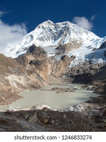 Mount Makalu and glacial lake near Mt Makalu base camp, Barun valley, Nepal Himalayas mountains
